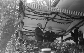 [President Harding and Mayor C.E. Tisdale on bandstand in Stanley Park.]