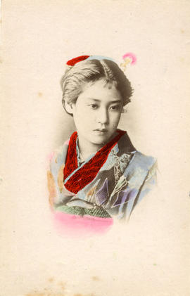 [Head and shoulders studio portrait of a woman in formal Japanese dress]
