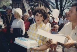 Boy carrying cake