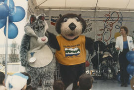 Wolf mascot, Tillicum and performers on the Chevron Stage at Playland for Tillicum's birthday party