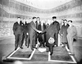[Babe Ruth shaking Mayor L.D. Taylor's hand on Pantages Theatre stage]