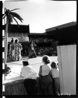 Crowd watching Hawaiian dancers on Electrical building stage