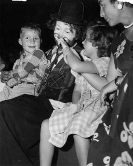 Clown with children at P.N.E.-Shrine Circus