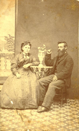 [Seated studio portrait of] Chester and Hannah Chadsley