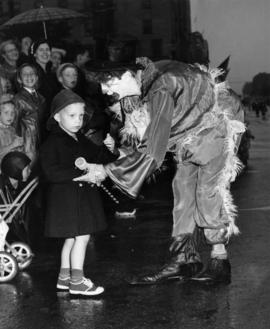 Clown speaking to young boy in 1950 P.N.E. Opening Day Parade