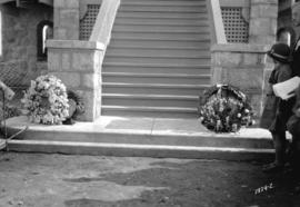 [Wreaths placed by stairs to park building during opening of Memorial Park]