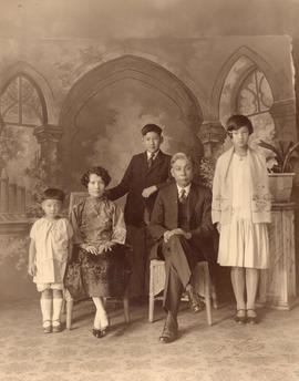 [Studio portrait of a family]