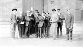 Group of immigration officials including Cyclone Taylor, second from left, during departure of Ch...