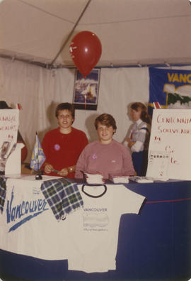 Two boys at Centennial souvenir booth during Canada Day celebrations