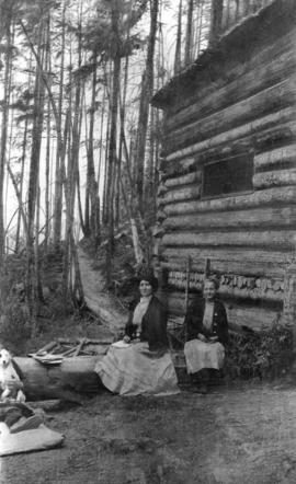 [Mrs. William Trythall and Miss Julia Stirtan beside Trythall's cabin on Grouse Mountain]
