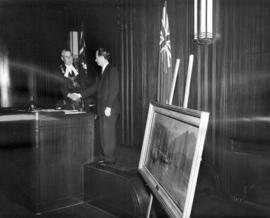 [Mayor Fred J. Hume receives a painting by John Innes from Ronald S. Ritchie]