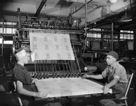 [Workers stacking sheets of printed paper at Westminster Paper Company]