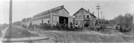 [View of teamsters and horse-drawn delivery wagons in front of Coast Lumber and Fuel Co. Ltd.]