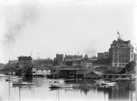 [View of Victoria waterfront, showing post office and boats in inner harbour]