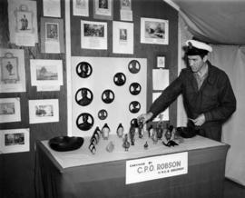 Section of Royal Canadian Navy display, carvings by C.P.O. Robson, H.M.C.S. Discovery