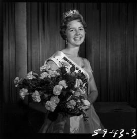 Winner of Miss Vancouver 1959 posing with flowers
