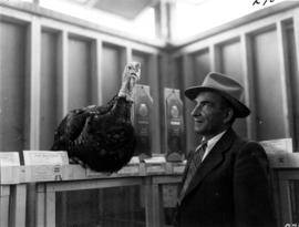 Man with award-winning turkey in 1955 P.N.E. Poultry and Pet Stock competition