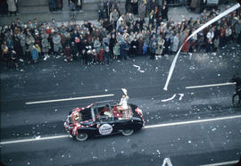 43rd Grey Cup Parade, on Granville Street, Miss Calgary Stampeders car, ticker tape, and spectators