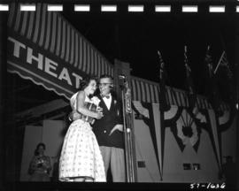 Carol Lucas, winner of Miss P.N.E. 1957, congratulated on Outdoor Theatre stage by P.N.E. directo...