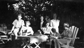 Group on lawn chairs at 5575 Angus Avenue