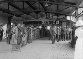 Military men waiting in line on a platform