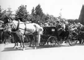 [Mr. J. McGuigan and others in a horse-drawn carriage at the Rededication of Stanley Park]