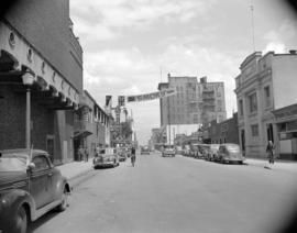 [View of Seymour Street looking north with an Orpheum movie banner hanging across the street]