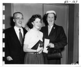 P.N.E. Honorary Treasurer J.F. Brown and P.N.E. director R.S. Quinn with girl