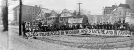 [Y.M.C.A. banner being held across Burrard Street in front of Wesley Methodist Church]