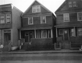 [Two one-and-one-half storey houses with pseudo-brick facades; centre one is 522 Keefer Street]