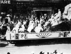 [An unidentified float in the 600 Block of Granville Street during a Victoria Day parade]