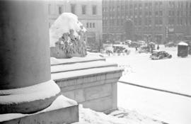 [A courthouse lion covered in snow]