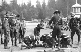[General Baden-Powell inspects first aid practice of the 1st Vancouver Troop at Hastings Park]