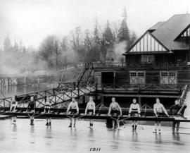 Vancouver Rowing Club eight crew on club float with clubhouse in background