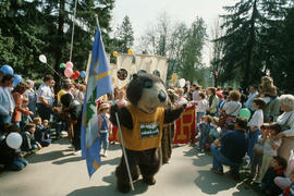 Tillicum leading march during Centennial birthday celebration in Stanley Park