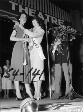 Nancy Hansen, winner of Miss P.N.E. 1954, being congratulated by the previous Miss P.N.E., Lynn A...