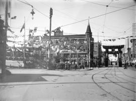 [Hastings Street at Cambie Street, decorated for the visit of the Duke and Duchess of Cornwall an...