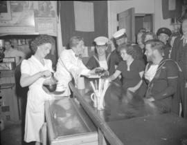 [Sailors and guests getting drinks at the Seamen's Club]