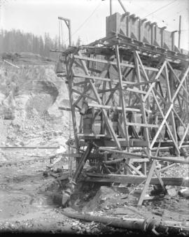 [Coquitlam Dam construction site, showing trestle and monitor in partially excavated area]