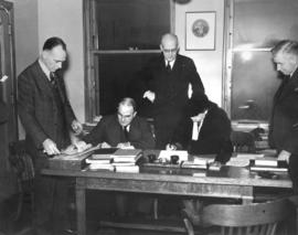 [Major and Mrs. J.S. Matthews sign documents to appoint responsibility for the Archives' holdings...