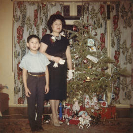 Mrs. Slim Wong with child at Christmas