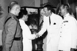 Member of International Commission for Supervision and Control in Vietnam shaking hands with Pres...