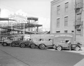King's [Motor Cartage] trucks [in front of the Union Steamship passenger entrance]