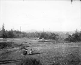 [Two women seated on grass at Beacon Hill Park]