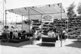 Columbia Sales and Service display of riding lawn mowers, snow plows, snowblowers, and snowmobiles