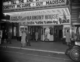 "[Exterior view of the Orpheum Theatre showing movie poster for ""Til the End of Time"" an..."