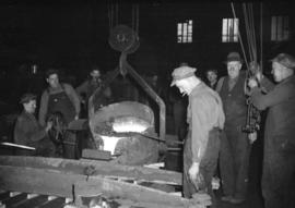[Workers at a smelting plant]