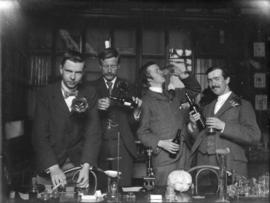 [Brown, Varty, Bullen and Sham in botany laboratory]