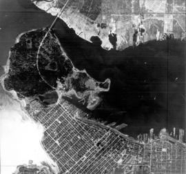 [Aerial survey view of First Narrows, Stanley Park, the West End, Downtown and North Vancouver]