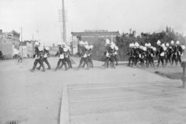 """Departing Under Full Orders"" [Yukon contingent Canadian soldiers marching north on Abb..."